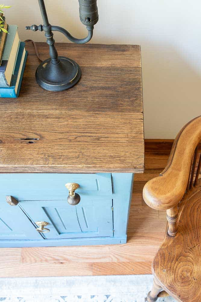 close up of wood top on washstand that was madeove by applying milk paint