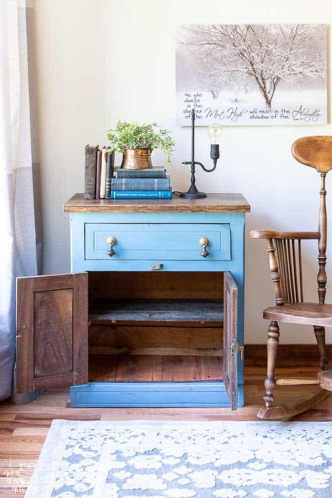 staged washstand after furniture makeover with cabinet doors open showing storage