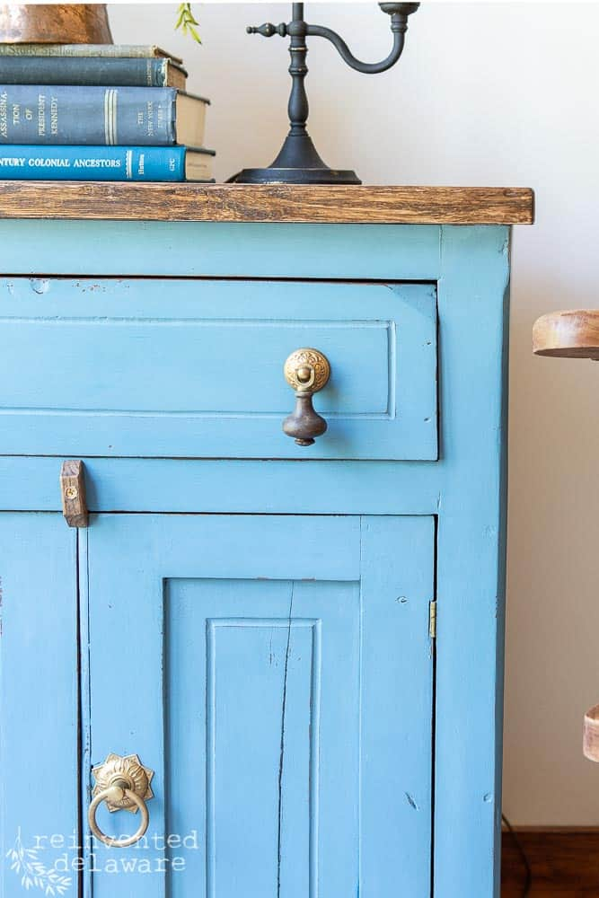 close up view of washstand after makeover showing how to apply milk paint