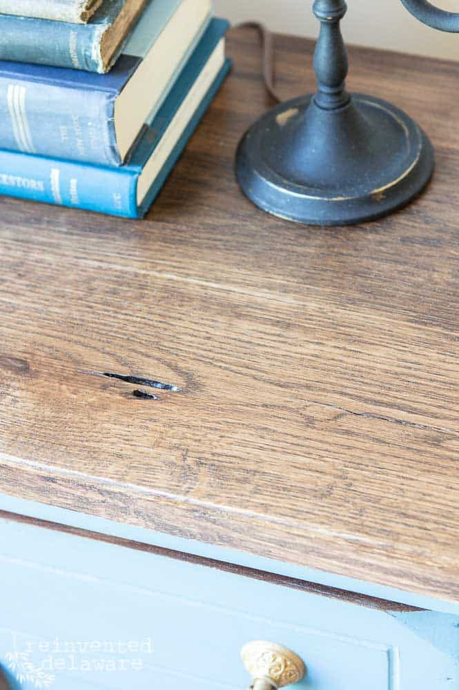 close up detail shot of wood top showing worm holes in reclaimed lumber wood top