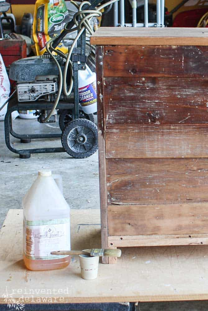 back of washstand showing difference between using hemp oil on old wood and without