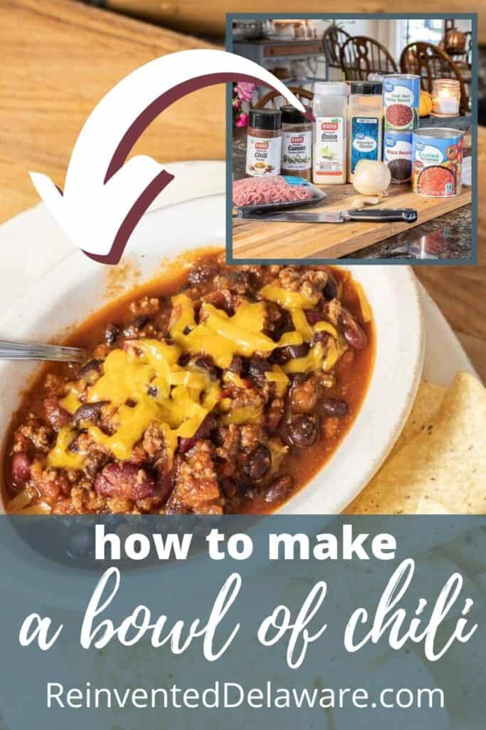 """Pinterest graphic showing a bowl of chili with ingredients in the background and text overly """"how to make a bowl of chili ReinventedDelaware.com'"""