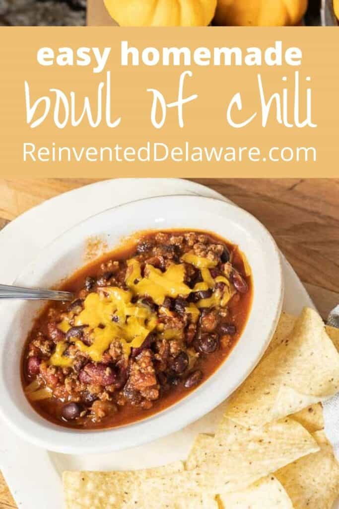 Pinterest graphic with bowl of chili and text overlay saying 'easy homemade bowl of chili' and reinventeddelaware.com