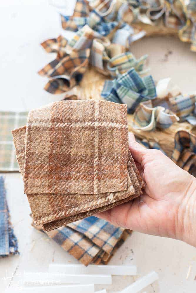 """stack of brown wool plaid scraps cut in 3"""" squares for diy fall wreath"""
