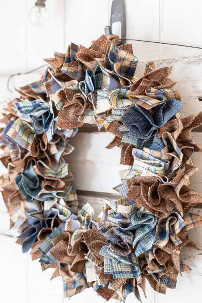 close up view of side of wool plaid wreath made from scraps of wool from thrift store