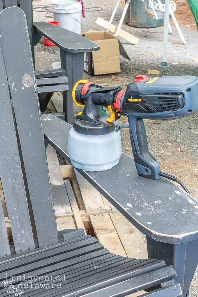 Wagner Flexio 2000 Power Paint Sprayer sitting on top of outdoor chairs that need a makeover