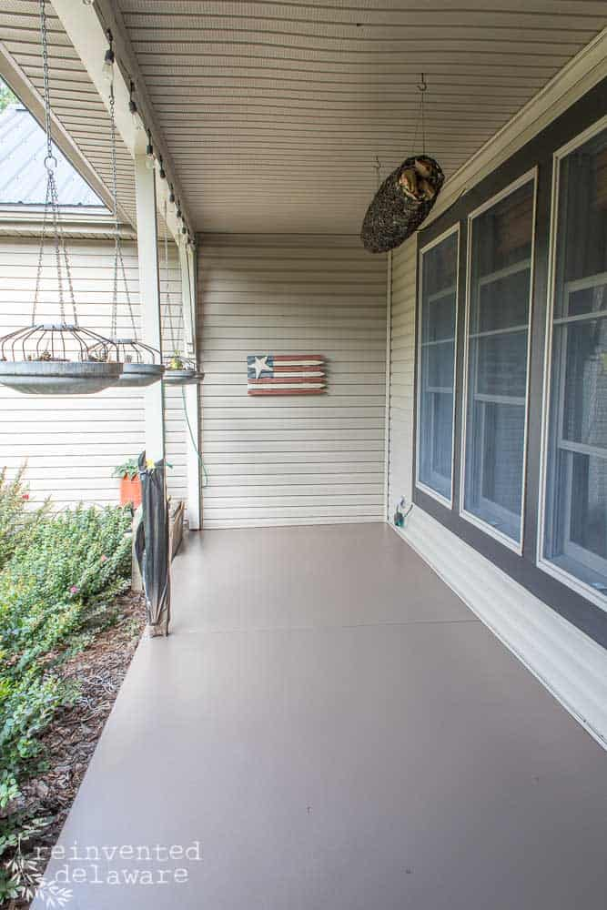 concrete front porch floor after being spray painted with a dark tan paint