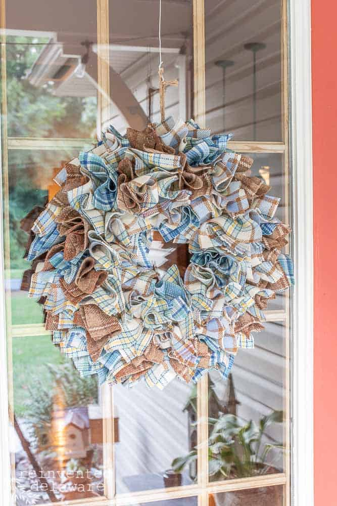 picture of a handmade cheap wool plaid wreath hanging on the front door
