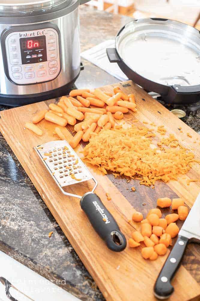 shredded carrots on a cutting board with Microplan shredder