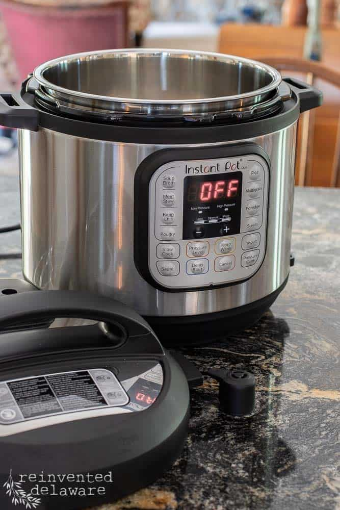 Instant Pot sitting on kitchen countertop with lid off