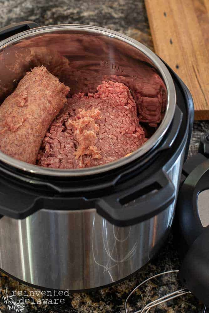 Instant Pot filled with ground beef and ground sausage