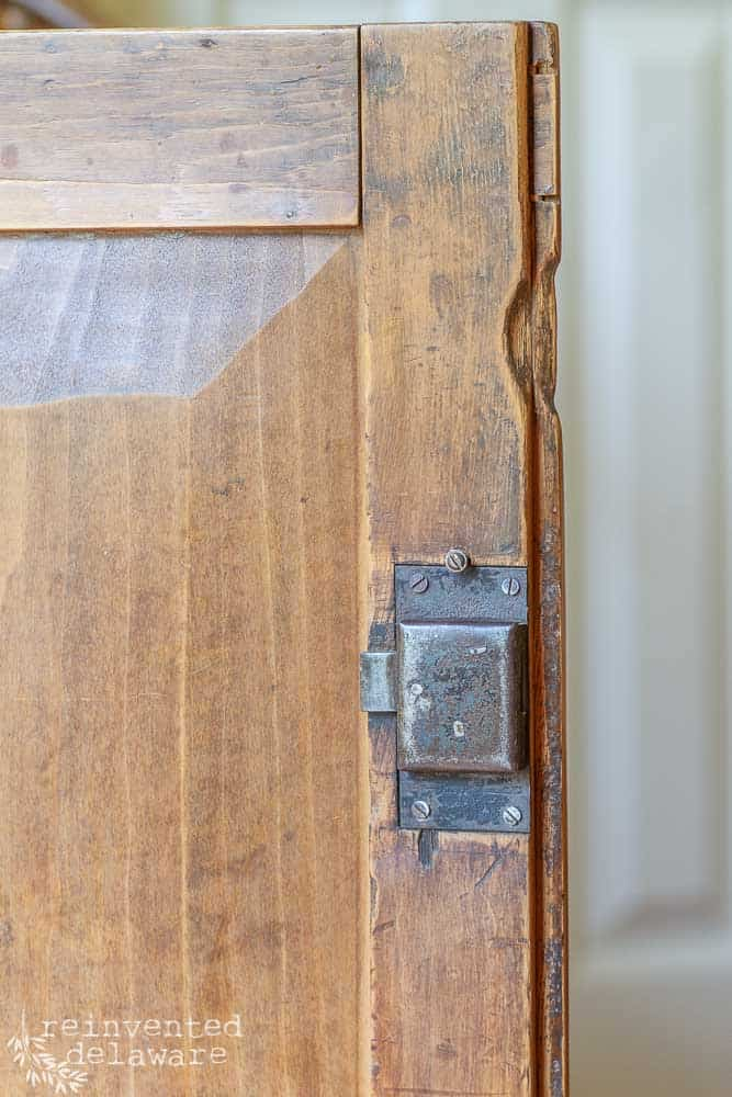 close up picture of hardware on an antique cupboard that was painted with milk paint, wood paint