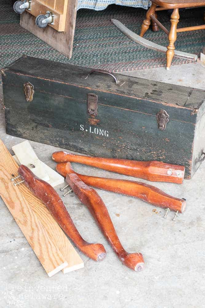 vintage tool chest on the floor with queen anne legs and lumber