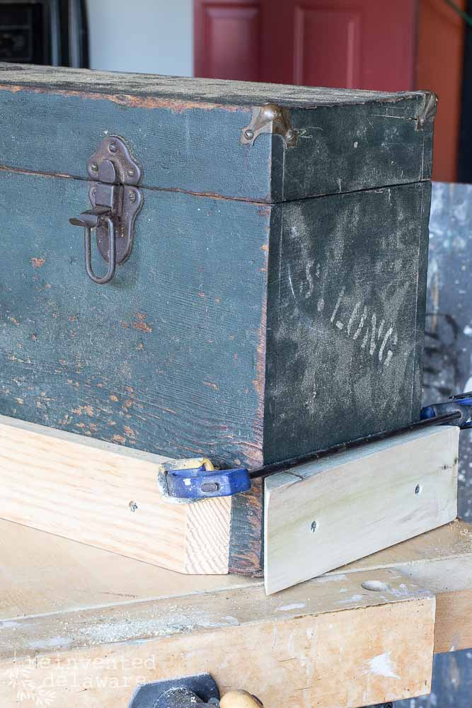 vintage wooden tool chest with lumber attached for addition of legs