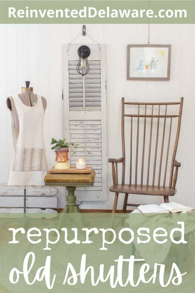 """Pinterest graphic with text overly """"repurposed old shutters"""" with an image of a shutter that was repurposed into a light and staged with a brown chair, an organ stool with knickknacks and a dress form with an apron on it"""