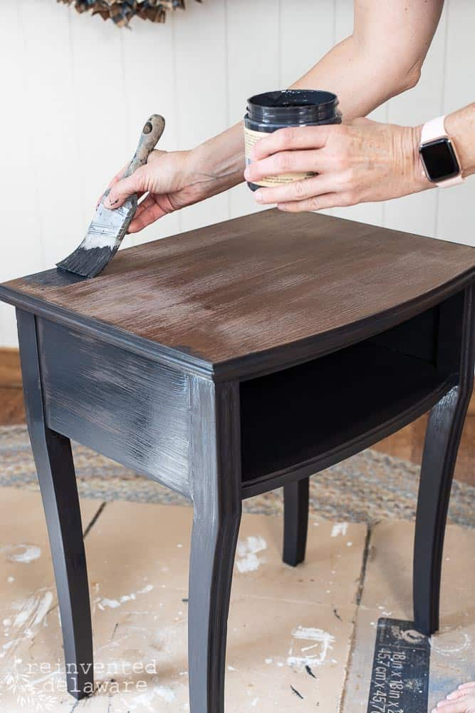 lady painting a small table with Dixie Belle Paint showing an idea of how to paint furniture