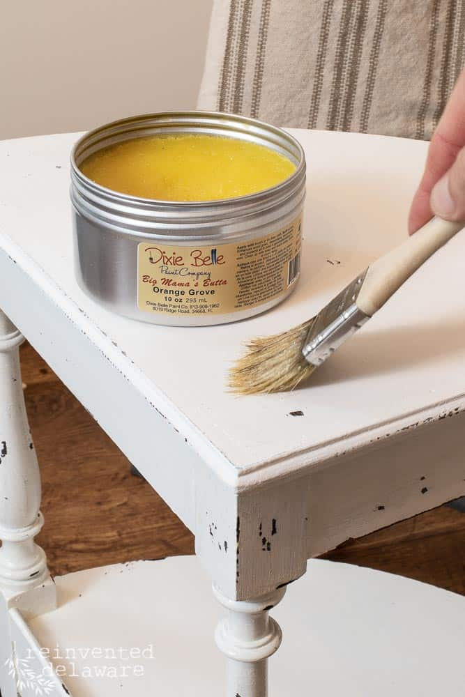 lady appyinbg Big Mama's Butta to surface of painted small table showing Dixie Belle Paint ideas
