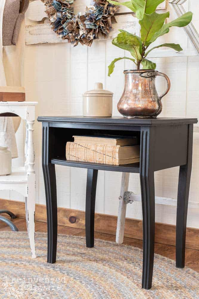 side view of small table painted in Dixie Belle Midnight Sky, a rich black, showing Dixie Belle Paint Ideas