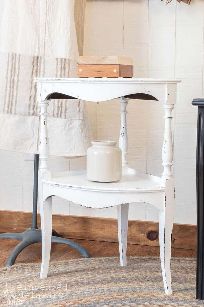 small table painted in Dixie Belle Cotton and staged with small crock and a small wooden box